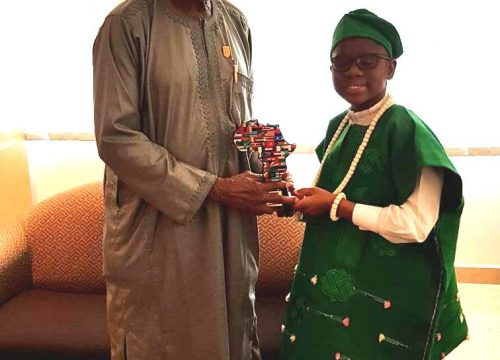 THE NIGERIA HIGH COMMISSIONER TO TANZANIA BLESSED MY AWARD